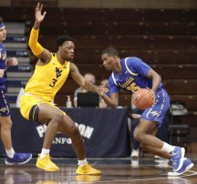 SIOUX FALLS, SD - NOVEMBER 25: Douglas Wilson #35 of the South Dakota State Jackrabbits drives toward Gabe Osabuohien #3 of the West Virginia Mountaineers during the Bad Boy Mowers Crossover Classic at the Sanford Pentagon in Sioux Falls, SD. (Photo by Richard Carlson/Inertia)