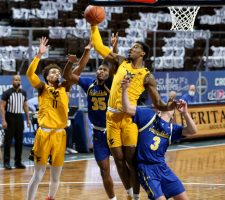SIOUX FALLS, SD - NOVEMBER 25: Gabe Osabuohien #3 of the West Virginia Mountaineers grabs a rebound against the South Dakota State Jackrabbits during the Bad Boy Mowers Crossover Classic at the Sanford Pentagon in Sioux Falls, SD. (Photo by Dave Eggen/Inertia)