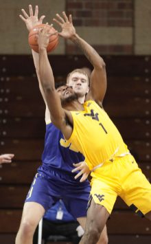 SIOUX FALLS, SD - NOVEMBER 25: Matt Dentlinger #32 of the South Dakota State Jackrabbits defends Derek Culver #1 of the West Virginia Mountaineers during the Bad Boy Mowers Crossover Classic at the Sanford Pentagon in Sioux Falls, SD. (Photo by Richard Carlson/Inertia)