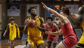 SIOUX FALLS, SD - NOVEMBER 27: Derek Culver #1 of the West Virginia Mountaineers drives toward Carson Williams #22 of the Western Kentucky Hilltoppers during the Bad Boy Mowers Crossover Classic at the Sanford Pentagon in Sioux Falls, SD. (Photo by Richard Carlson/Inertia)