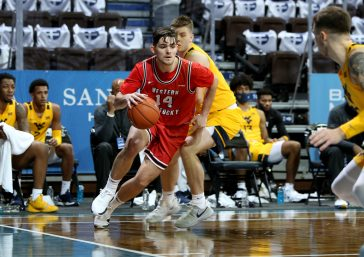 SIOUX FALLS, SD - NOVEMBER 27: Luke Frampton #14 of the Western Kentucky Hilltoppers drives baseline against the defense from the West Virginia Mountaineers during the Bad Boy Mowers Crossover Classic at the Sanford Pentagon in Sioux Falls, SD. (Photo by Dave Eggen/Inertia)