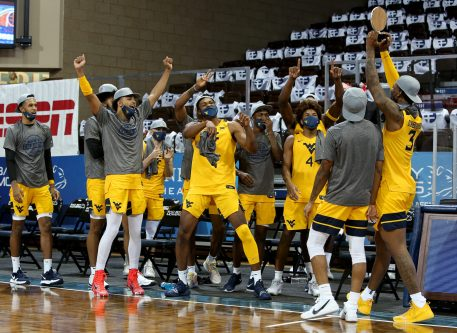 SIOUX FALLS, SD - NOVEMBER 27: West Virginia Mountaineers celebrate following their 70-64 win over Western Kentucky Hilltoppers in the Bad Boy Mowers Crossover Classic at the Sanford Pentagon in Sioux Falls, SD. (Photo by Dave Eggen/Inertia)