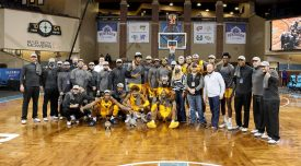 SIOUX FALLS, SD - NOVEMBER 27: West Virginia Mountaineers pose for a team photo following their 70-64 win over Western Kentucky Hilltoppers in the Bad Boy Mowers Crossover Classic at the Sanford Pentagon in Sioux Falls, SD. (Photo by Dave Eggen/Inertia)