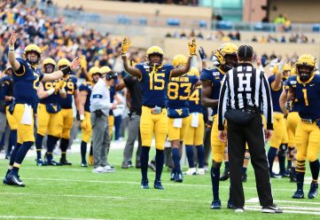 Wide receiver George Campbell (15) and QB Jarrett Doege signal touchdown while waiting for an official review.