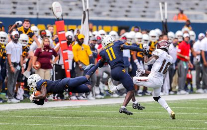 Sep 12, 2020; Morgantown, West Virginia, USA; West Virginia Mountaineers cornerback Alonzo Addae (4) intercepts a pass during the second quarter against the Eastern Kentucky Colonels at Mountaineer Field at Milan Puskar Stadium. Mandatory Credit: Ben Queen-USA TODAY Sports
