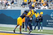April 24, 2021; Morgantown, West Virginia, USA; West Virginia Mountaineers wide receiver Bryce Ford-Wheaton (0) attempts to catch a pass over West Virginia Mountaineers cornerback Jackie Matthews (3) during the Spring Game at Mountaineer Field at Milan Puskar Stadium. Mandatory Credit: Ben Queen