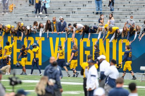 April 24, 2021; Morgantown, West Virginia, USA; West Virginia Mountaineers players celebrate with fans following the Spring Game at Mountaineer Field at Milan Puskar Stadium. Mandatory Credit: Ben Queen
