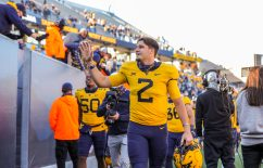 Oct 31, 2020; Morgantown, West Virginia, USA; West Virginia Mountaineers quarterback Jarret Doege (2) celebrates with fans after defeating the Kansas State Wildcats at Mountaineer Field at Milan Puskar Stadium. Mandatory Credit: Ben Queen-USA TODAY Sports