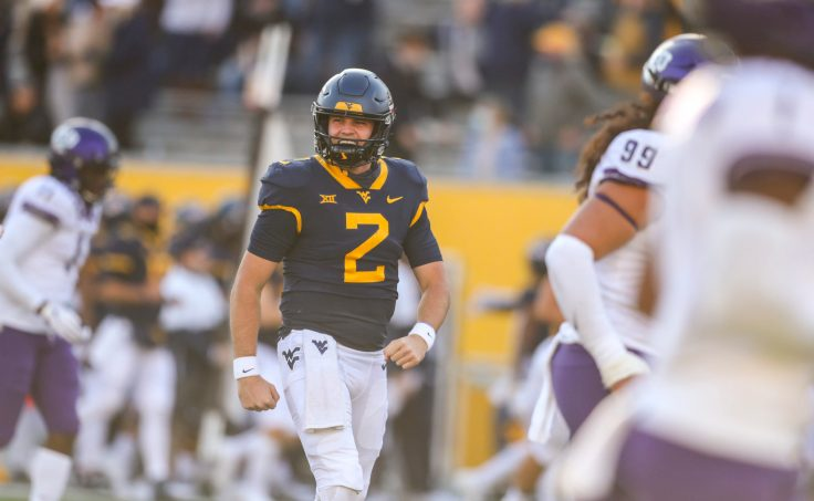 Nov 14, 2020; Morgantown, West Virginia, USA; West Virginia Mountaineers quarterback Jarret Doege (2) celebrates after throwing a touchdown during the fourth quarter against the TCU Horned Frogs at Mountaineer Field at Milan Puskar Stadium. Mandatory Credit: Ben Queen-USA TODAY Sports
