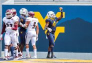 Sep 12, 2020; Morgantown, West Virginia, USA; West Virginia Mountaineers running back Leddie Brown (4) celebrates a touchdown during the first quarter against the Eastern Kentucky Colonels at Mountaineer Field at Milan Puskar Stadium. Mandatory Credit: Ben Queen-USA TODAY Sports
