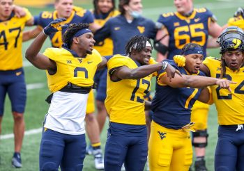 """April 24, 2021; Morgantown, West Virginia, USA; West Virginia Mountaineers players sing """"Country Roads"""" at the end of the Spring Game at Mountaineer Field at Milan Puskar Stadium. Mandatory Credit: Ben Queen"""