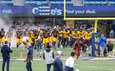 April 24, 2021; Morgantown, West Virginia, USA; The West Virginia Mountaineers run onto the field during the Spring Game at Mountaineer Field at Milan Puskar Stadium. Mandatory Credit: Ben Queen