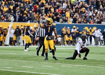 Wide receiver TJ Simmons signals a Mountaineer first down.