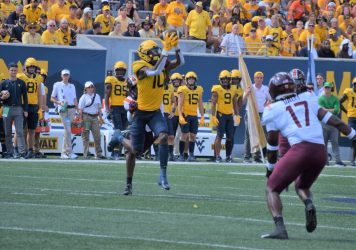 WR Sean Ryan catches a pass against the Hokies. Fans cheer on the Mountaineers. (WVSN photo by Kelsie LeRose)