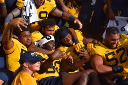 Players celebrate with fans after brining the Black Diamond trophy back to Morgantown. (WVSN photo by Kelsie LeRose)