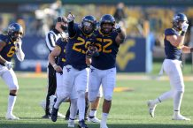 MORGANTOWN, WV - NOVEMBER 14: West Virginia Mountaineers safety Sean Mahone (29) and West Virginia Mountaineers defensive lineman Jalen Thornton (52) celebrate after Mahone recovered a fumble on a punt return during the fourth quarter of the college football game between the TCU Horned Frogs and the West Virginia Mountaineers on November 14, 2020, at Mountaineer Field at Milan Puskar Stadium in Morgantown, WV. (Photo by Frank Jansky/Icon Sportswire)