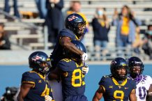 MORGANTOWN, WV - NOVEMBER 14: West Virginia Mountaineers tight end T.J. Banks (85) lifts West Virginia Mountaineers wide receiver T.J. Simmons (1) into the air after Simmons scored on a 38-yard pass during the fourth quarter of the college football game between the TCU Horned Frogs and the West Virginia Mountaineers on November 14, 2020, at Mountaineer Field at Milan Puskar Stadium in Morgantown, WV. (Photo by Frank Jansky/Icon Sportswire)