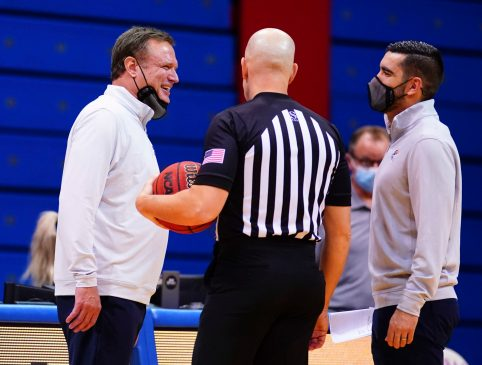 Kansas head coach Bill Self laughs with a game official while disputing a call during the second half, Tuesday, Dec. 22, 2020 at Allen Fieldhouse.