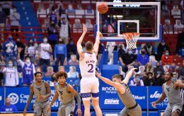 KU's Christian Braun shoots over West Virginia's Sean McNeil during the first half of Tuesday night's Big 12 Conference game at Allen Fieldhouse.