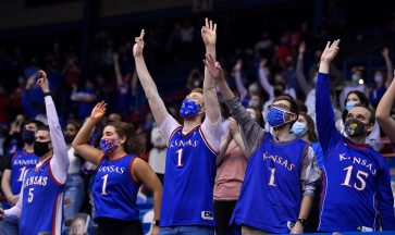 A more sparsley populated student section cheer on the KU Jayhawks during their game Tuesday night against West Virginia.