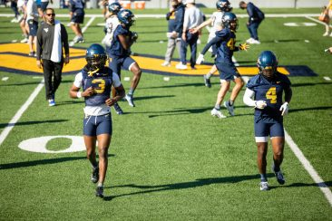 Cornerbacks Jackie Matthews, left, and Alonzo Addae, right, warm up during a WVU Football practice on March 27, 2021 in Milan Puskar Stadium. (Duncan Slade/WVSportsNow)