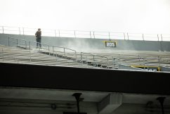 A worker pressure washes the stands during a practice in Milan Puskar Stadium on Saturday April 17, 2021. Duncan Slade/WVSN