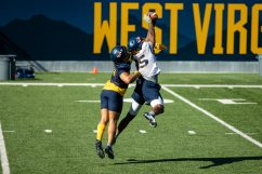 Two WVU players go up for a catch during a WVU Football practice on March 27, 2021 in Milan Puskar Stadium. (Duncan Slade/WVSportsNow)