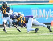 West Virginia Mountaineers safety Tykee Smith (23) makes a tackle against TCU Horned Frogs on Saturday, Nov. 14, 2020, in Morgantown, W.Va.