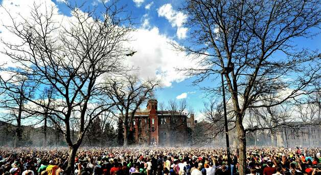 """FILE - In this April 20, 2009 file photo thousands of people fill Norlin Quad during the annual """"420"""" event at the University of Colorado in Boulder, Colo. The University of Colorado is closing its campus to outsiders on Friday, April 20, 2012 and closing the Norlin Quad to prevent a 420 gathering. For years, the term """"420"""" was a kind of code. But the term, and the holiday, have become more mainstream as more attention has been focused on marijuana issues. (AP Photo/The Daily Camera, Mark Leffingwell) Photo: Mark Leffingwell / AL"""