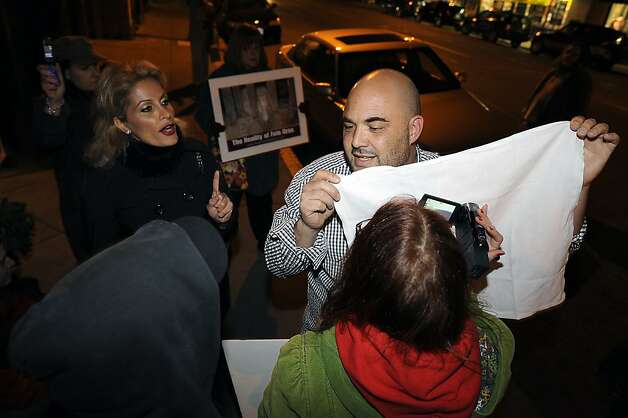 """An unamed patron gets into a heated exchange with protestors outside the restaurant who he said are disturbing his dinner.   Protesters gathered in front of Baywolf restaurant  in Oakland, CA to protest their special """"Farewell to Foie Gras"""" dinner Sunday Feb. 26th, 2012 Photo: Michael Short, Special To The Chronicle"""