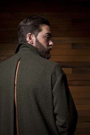 Dior Homme olive wool overcoat with zipper back, $2,350, Christian Dior. Photo: Russell Yip, The Chronicle