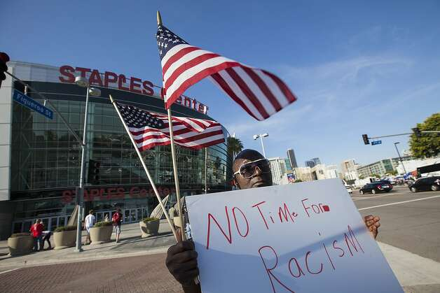 Protest outside the Staples in response to LA Clippers owner Donald Sterling's recent racist comments. The protest was small due to the NBA commissioner's decision about Sterling earlier in the day. Photo: Ted Soqui, Ted Soqui For The Chronicle