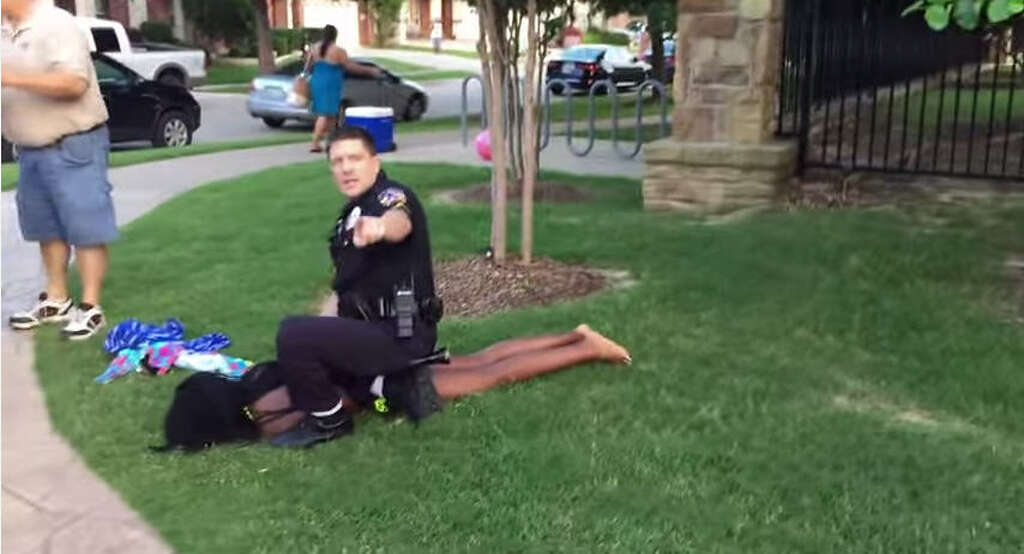 A now-suspended police officer arrests juveniles allegedly involved in a fight at a community pool in McKinney, Texas on June 5, 2015. Photo: YouTube