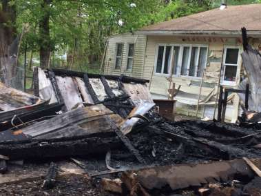 A black family woke up Sunday night to find their detached garage sprayed with hateful graffiti and engulfed in flames, town police Schodack Chief Joseph Belardo said Monday.The parents and their five children— who are all under the age of 10— were physically unharmed but emotionally traumatized by the fire set at 29 Cold Spring Ave., the chief said.  A black family woke up Sunday night to find their detached garage sprayed with hateful graffiti and engulfed in flames, Schodack Police Chief Joseph Belardo said Monday, May 15, 2017.The parents and their five children— who are all under the age of 10— were physically unharmed but emotionally traumatized by the fire set at 29 Cold Spring Ave., the chief said.(Robert M. Gavin/Times Union) Photo: Robert Gavin