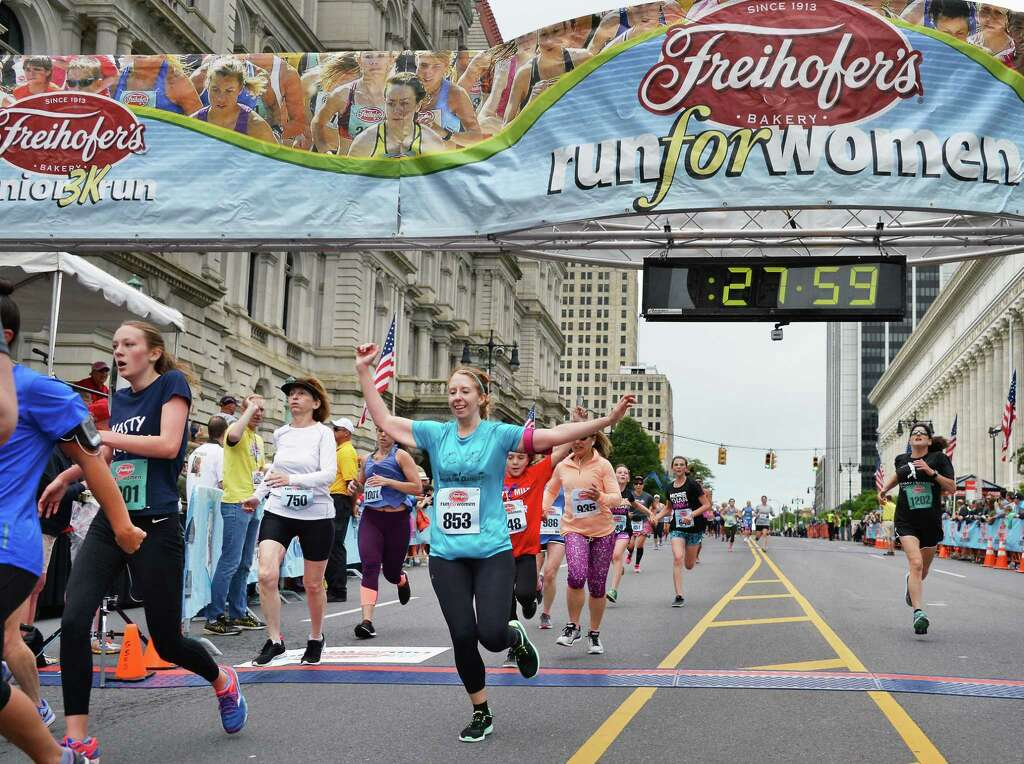Runners cross the finish line for the Freihofer's Run for Women Saturday June 3, 2017 in Albany, NY. (John Carl D'Annibale / Times Union) Photo: John Carl D'Annibale / 40040636A