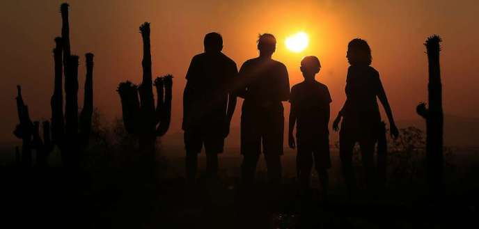 FILE - In this May 20, 2012, file photo, people view an annular solar eclipse as they look towards the setting sun on the horizon in Phoenix. Destinations are hosting festivals, hotels are selling out and travelers are planning trips for the total solar eclipse that will be visible coast to coast on Aug. 21, 2017. A narrow path of the United States 60 to 70 miles wide from Oregon to South Carolina will experience total darkness, also known as totality. (AP Photo/Ross D. Franklin, File) Photo: Ross D. Franklin, Associated Press  - 920x1240 - Total solar eclipse to create narrow dark path across U.S.