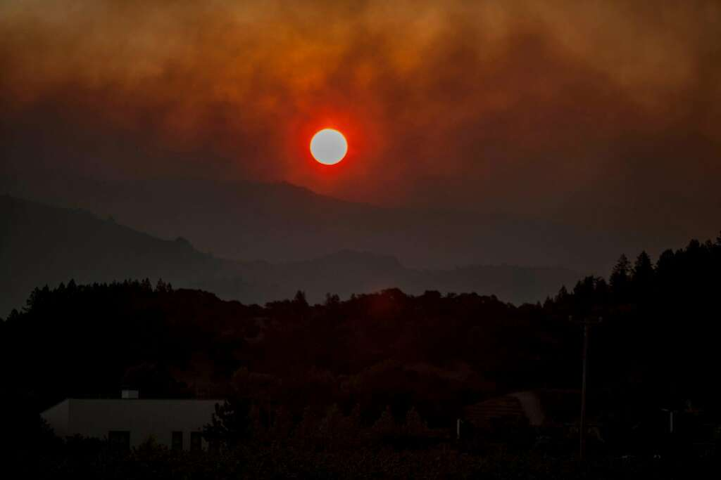 Sun rise over the city of Napa as a fast moving wind whipped wild fire raged though the Napa/Sonoma wine region on Oct. 9, 2017. Photo: Peter DaSilva, Special To The Chronicle