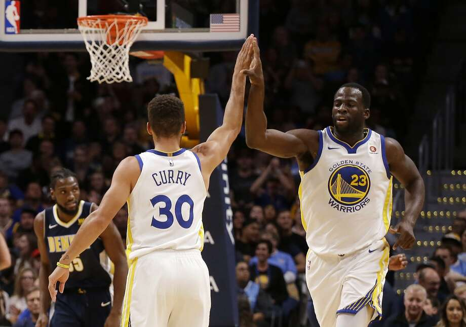 Golden State Warriors forward Draymond Green (23) high fives Stephen Curry after Curry hit a three pointer against the Denver Nuggets during the third quarter of an NBA basketball game Saturday, Nov. 4, 2017, in Denver. Photo: Jack Dempsey, Associated Press