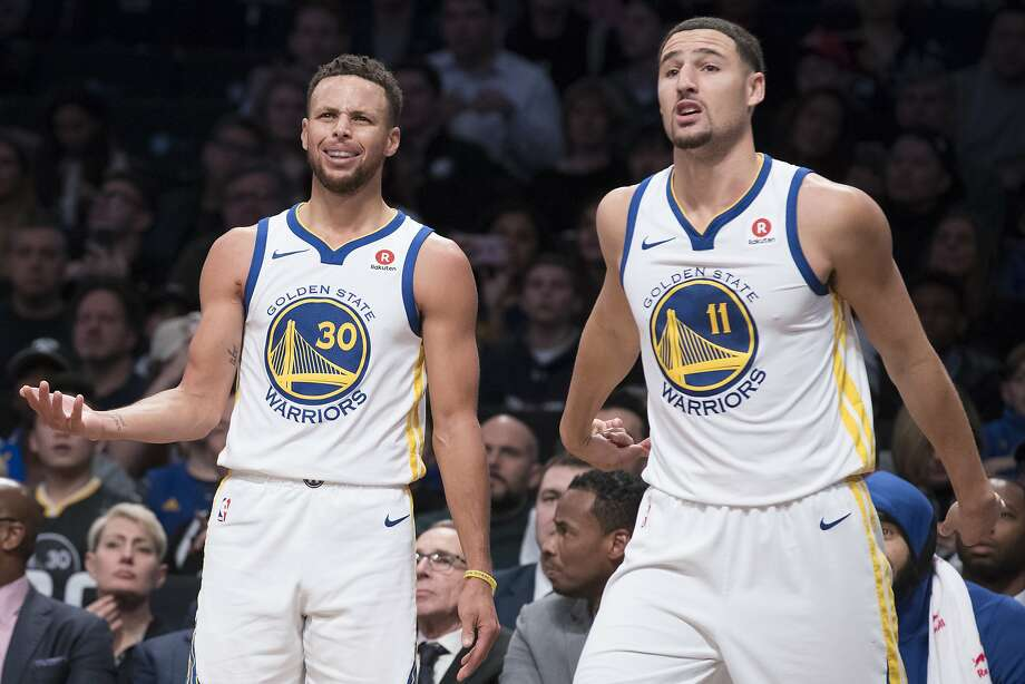 Golden State Warriors guard Stephen Curry (30) and guard Klay Thompson (11) react to a call by the referee during the first half of an NBA basketball game against the Brooklyn Nets, Sunday, Nov. 19, 2017, in New York. (AP Photo/Mary Altaffer) Photo: Mary Altaffer, Associated Press
