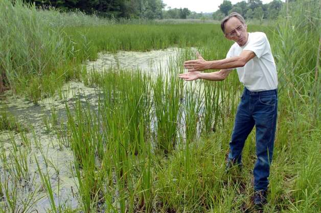John O'Neill, of the Bethel Land Trust, stands near Ivy Island in Bethel, which was once owned by PT Barnum