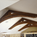 Faux wood beam arches add character and a dramatic focal point to any