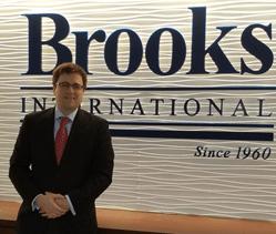 Brooks International promotes Jacob McAuliffe to Managing Analyst.