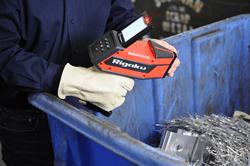 Rigaku KT-100S Handheld LIBS spectrometer analyzing aluminum