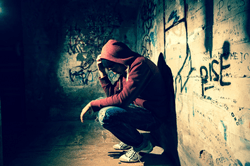 Sad homeless youth