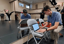 Florida Polytechnic University students monitor biosensor data generated by the movements of a Florida Dance Theatre dancer in early March.