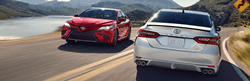 Red and Silver 2020 Toyota Camry Models on a Coast Road