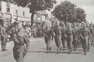 Polish troops march through an English town during the summer of 1940