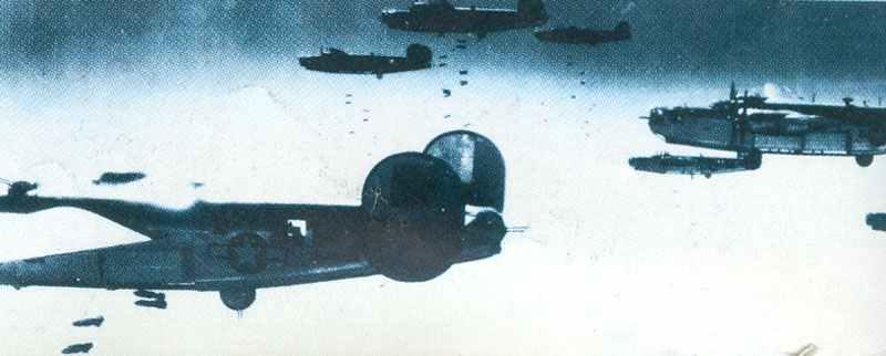 Bombs rain down from B-24Hs