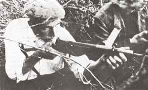 French resistance fighter using a Mark 2 Sten gun