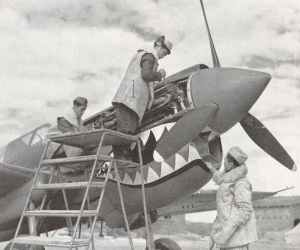 Chinese ground crew work on a Curtiss P-40